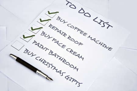 organising: Tod do list with buy christmas gifts unchecked Stock Photo