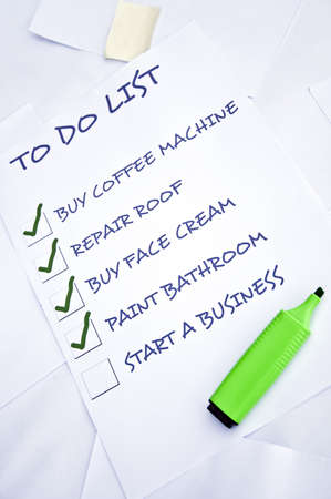 organising: To do list with start a business unchecked Stock Photo