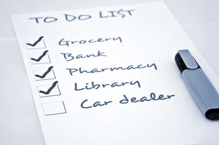 rent index: To do list with car dealer Stock Photo