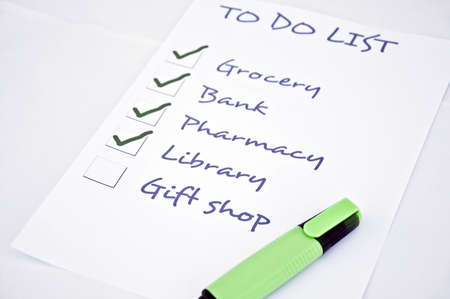 organising: To do list with gift shop Stock Photo