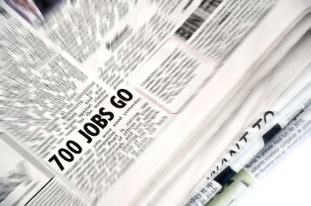 Newspaper article with 700 jobs go highlighted Stock Photo - 8443681