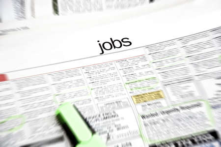 job advertisement: Job ads in newspaper  page with marker and some jobs marked Stock Photo