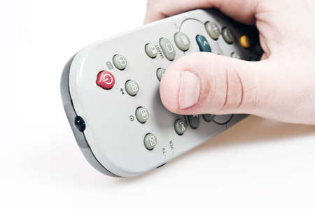 Male hand holding tv remote control photo