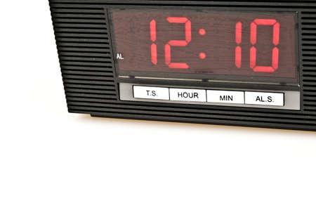 Clock showing 12:10 isolated on white background photo