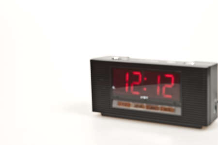 Blured clock showing 12:12 isolated on white background Stock Photo - 8766007