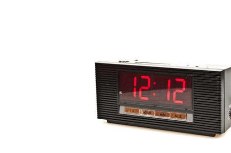 Clock showing 12:12 isolated on white background photo