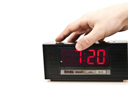 Male hand stopping alarm clock photo