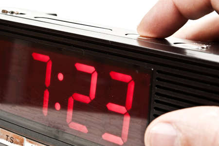Male hand stopping alarm clock Stock Photo - 8766244