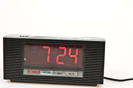 Clock showing 7:24 isolated on white background Stock Photo - 8766177