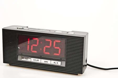 Clock showing 12:25 isolated on white background photo