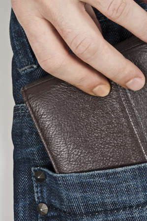 grabbing at the back: Wallet in jeans back pocket
