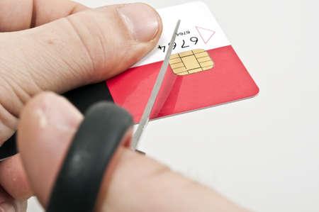 Male hand cut credit card photo