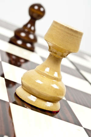 strategic advantage: Rook and pawn closeup on chessboard Stock Photo