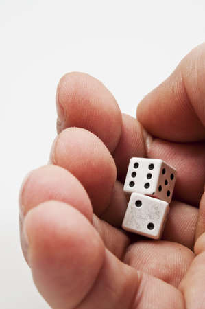 Isolated closeup of two dice ready to throw photo
