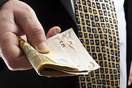 Business man offering bunch of euro banknotes photo
