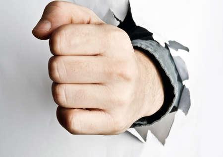 Male fist broke white paper Stock Photo - 8767029