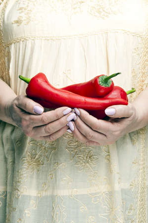 Housewife holding bunch of peppers photo