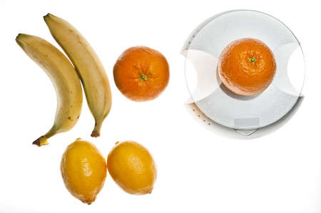 Isolated fruits and food scale photo