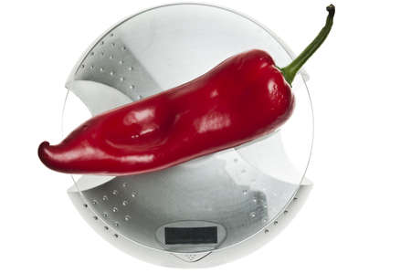 Red pepper isolated on food scale photo