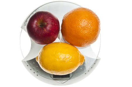 Mix of fruits isolated on food scale photo