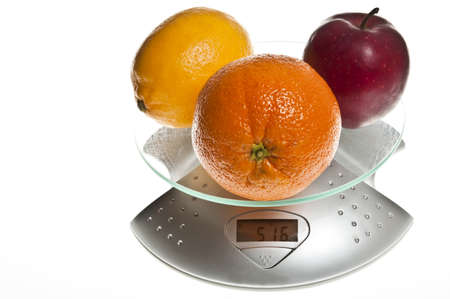glycemic: Mix of fruits isolated on food scale