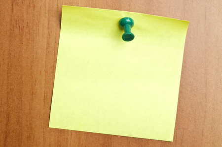 Empty green post it on wooden wall photo