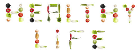 Healthy life words made of different type of vegetables photo