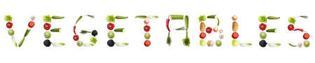 Vegetables word made of different type of vegetables photo