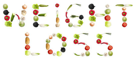 Weight loss words made of different type of vegetables photo
