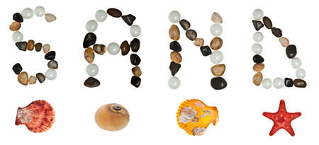 Sand word made of stones and sea objects photo