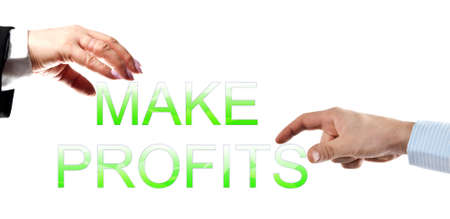 make profits words builded by business woman and man hands photo