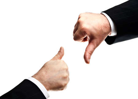 Isolated mature business man hands showing Yes and No signs photo