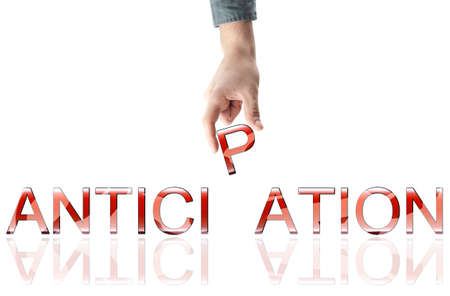 anticipate: anticipation word made by male hand Stock Photo