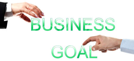 Business goal words made by business woman and man hands photo