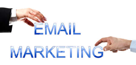 email marketing: Email marketing words made by business woman and man hands Stock Photo