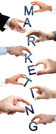 Marketing word made by many business people hands Stock Photo - 8925133