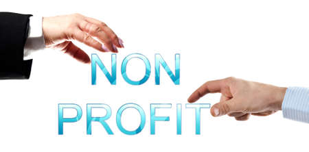 nonprofit: Non profit words made by business woman and man hands