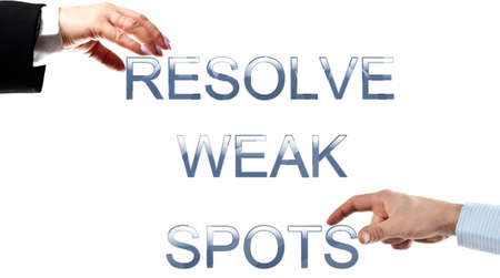 resolve: Resolve weak spots words made by business woman and man hands Stock Photo