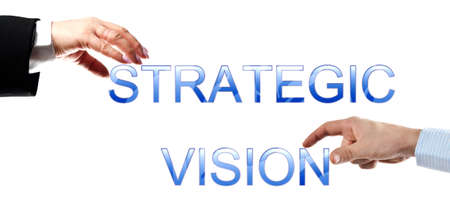 team vision: Strategic vision words made by business woman and man hands Stock Photo