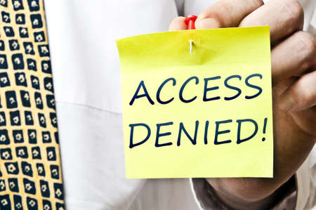Access denied post it in business man hand Stock Photo - 8925390