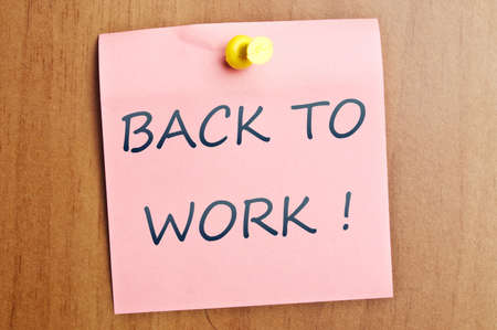 Back to work post it on wooden wall Stock Photo - 8925375