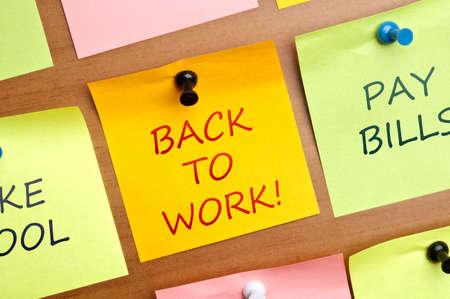 Back to work post it on wooden wall Stock Photo - 8925333