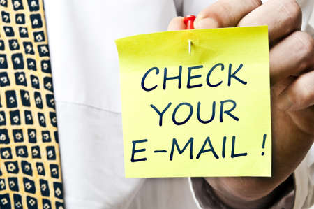 Check your e-mail post it in business man hand photo