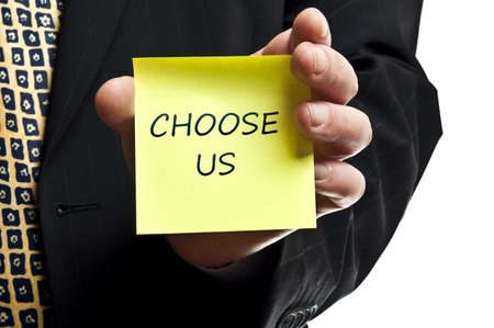 choose person: Choose us post it in business man hand