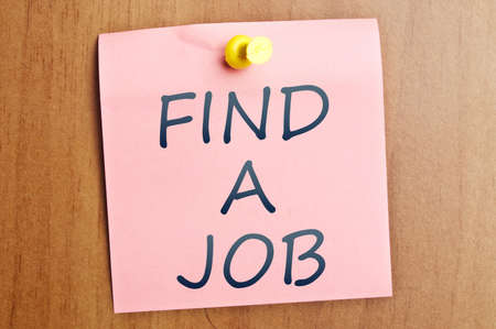 Find a job post it on wooden wall photo