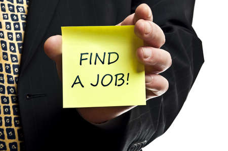 job advertisement: Find a job post it in business man hand Stock Photo