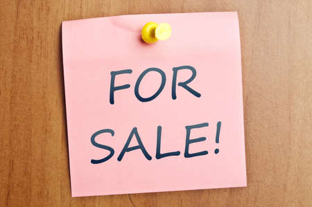 For sale word  post it on wooden wall Stock Photo - 8925363