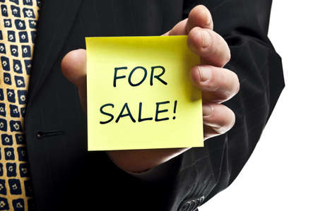 For sale post it in business man hand photo