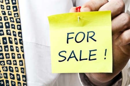 For sale post it in business man hand Stock Photo - 8925379