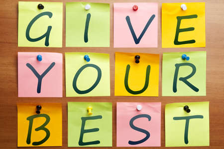 Give your best made by post it Stock Photo - 8925318